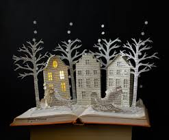book 3d paper art created by cutting the book pages in the form of houses trees and things to during snowy nights