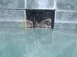 rust stain on tile tile before repair behind tile