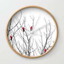 artistic bright red birds on tree