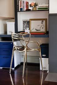 A Sleek Gold Kartell Chair Elevates A Minimal Corner Work Space