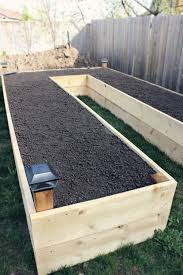 how to make a raised garden bed.  Bed Above Ground Garden This Shape Makes It Easier To Walk Around Each Plant With How To Make A Raised Garden Bed