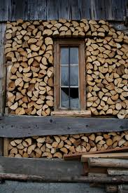 Cord Wood - stacked around a window. Creating an overhang to keep firewood  relatively dry is a good idea, but I feel like it would be necessary to  create ...