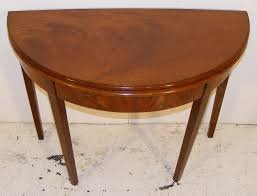 mahogany and line inlaid half round fold over tea table