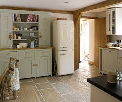 country kitchen ideas. country homes and interiors kitchen with smeg fridge. modern style: fridges click through for details. love the units made to look like a ideas