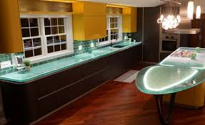 the recycled glass counters look especially nice when lit up and the glass subway tile backsplash is a good match