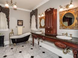 bathroom with acrylic vintage clawfoot tub with gold lion feet