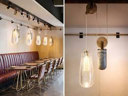 Pendant lighting for restaurants Contemporary This Restaurant Is Filled With Pendant Lighting On Pulley System Contemporist This Restaurant Is Filled With Pendant Lighting On Pulley System