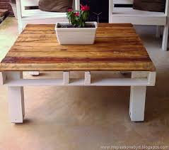 diy outdoor pallet coffee table with a white base via inspirationsbyd