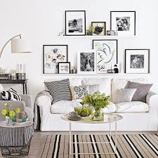 A gallery wall is the perfect fit & makes it super easy to switch it. White Living Room Ideas Ideal Home