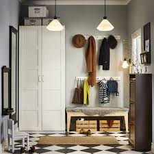 ikea hallway furniture. a hallway with white wardrobe and brown shoe cabinet that holds at least 12 ikea furniture