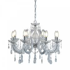 a traditional design with a modern twist this ceiling light is luxuriously adorned with crystal drops barley twist arms and glass ts that creates a