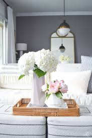 add a little faux peony arrangement like this one inside of a marble tray find my marble tray here and there you have a simple beautiful arrangement to