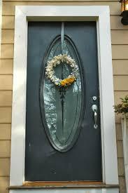 front door wreath hangerDecor Ashland Wreath Hanger With Oval Glass Door And Wood Wall