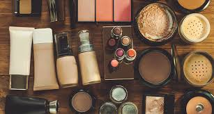 a tabletop full of an ortment of makeup