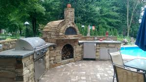 enhance your outdoor experience with a fully functional outdoor kitchen gas or wood fire fireplace or even a wood fired pizza oven