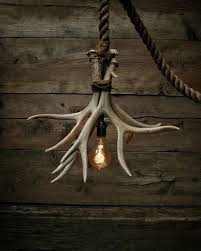 this is the cabin lit chandelier ive used 3 grade a antler sheds that have been securely bonded and wrapped using rustic metal twine for aesthetics
