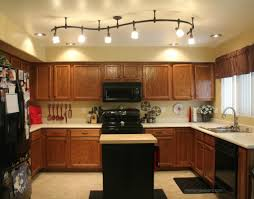 recessed outstanding decoration kitchen lighting design ideas with brown wooden kitchen cabinet using six recessed lighting along brown backsplash with backsplash lighting