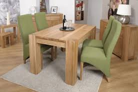 dining room fantastic design ideas using rectangular grey rugs and brown wooden tables also with green fabric stacking chairs fair designs covered chai simple neat 687x456