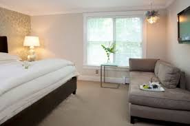 bedroom chaise lounge chairs. Grey Chaise Lounge Chair And White Bed For Cozy Bedroom Ideas Chairs