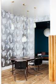 city light inspired wallpaper and dangling light fixture in the dining room dining room ls