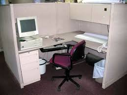 office cubical. An Office Cubicle With A Computer, Phone And Little Else. Cubical