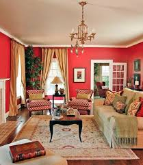 the red accents throughout this living room match the rich red walls that surround the room