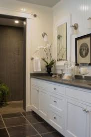 white bathroom cabinets with granite. The Master Bathroom Has Black Granite Countertops With Double Vanity Sinks, And A Special Bathtub Given To Homeowner, Deann\u2026 White Cabinets O