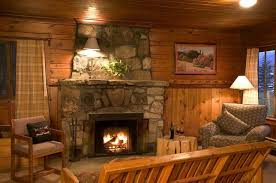 cozy living room with fireplace. Living Room With Rustic Stone Fireplace And Wood Panels Cozy