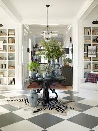 absorbing round entry table beach design for the hall with potted plants and zebra carpet under transpa floating chandelier ideas