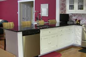 image of white kitchen cabinets with dark countertops
