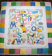 BABY QUILTS - Beautiuful hand-quilted baby quilts from THE ... & ABC Baby Quilt - Pastel Adamdwight.com