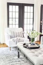 beautiful bright living room in clic shades of white and grey howard style armchair