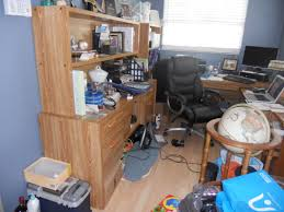 before with no storage space in home office was used as a catch all catch office space organized