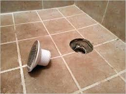 shower drain leaking shower drain leaking tile shower drain height how to fix a leaking image bathroom for inspire upstairs shower drain leaking through