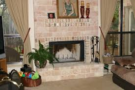prefab fireplace with stone facing designed to make it look like a masonry firelace