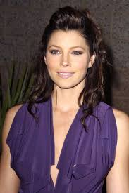 The actress accents her purple dress with violet smoky eyes and a.