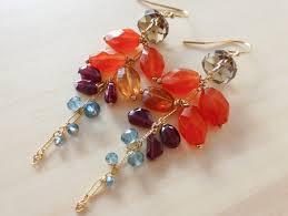 the paradise flower earrings orange carnelian with red garnet and london blue topaz dangle earrings