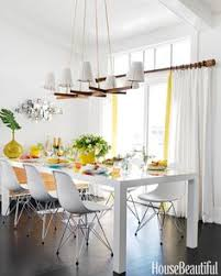 bright and colorful surfer chic beach house white dining table love that chandelier unique