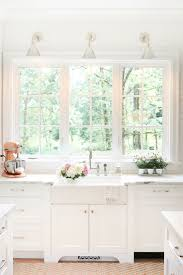lighting kitchen sink kitchen traditional. coastal inspired kitchen renovation citrineliving pendant lights and sconces lighting sink traditional