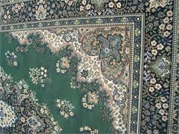 detail shot of green and blue persian rug