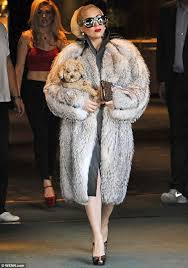 lady gaga steps out in bulgaria wearing a large fur coat and carrying