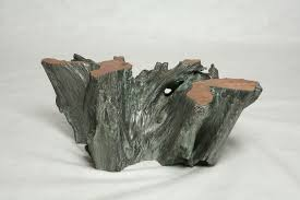 custom made silver covered tree trunk coffee table