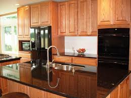 image of small kitchens with black appliances