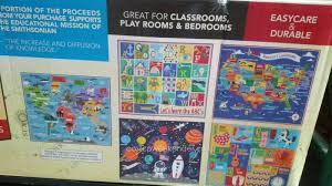 smithsonian education rug with an assortment of prints
