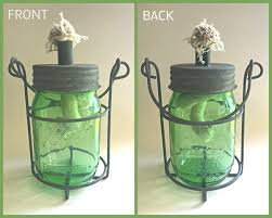 one authentic ball heritage collection green ball mason jar with rustic barn roof oil lamp and carrying handle