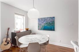 round marble dining table with trendy chairs