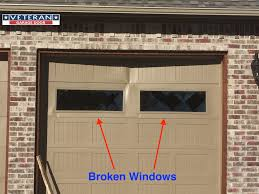broken garage door windows