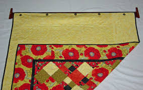 easyDisplay Decorative Quilt Hanger - Instructions & Hang quilt hanger back on the wall with quilt attached. Adamdwight.com