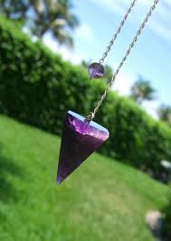 holding my black amethyst pendulum out in the sun so i can see all its inner