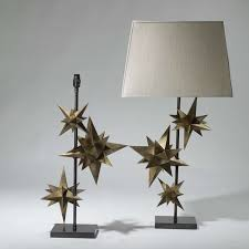 pair of medium threehand painted antique gold star lamps